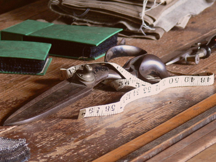 Title: St.Fagans National History Museum ( Cardiff ). Tailor's shop ( 1926 ): Workshop - tailor scissors. Source: Wikimedia Commons. Author: Wolfgang Sauber. License: Creative Commons attribution-share alike 3.0 Unported.
